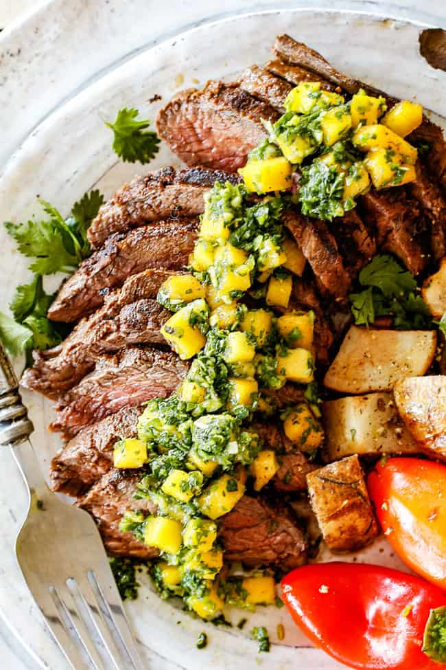 top view of Brazilian Chimichurri steak sliced on a plate with chimichurri