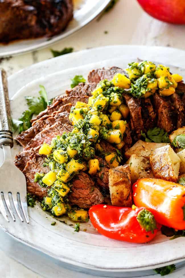 Brazilian Chimichurri steak sliced on a plate with chimichurri