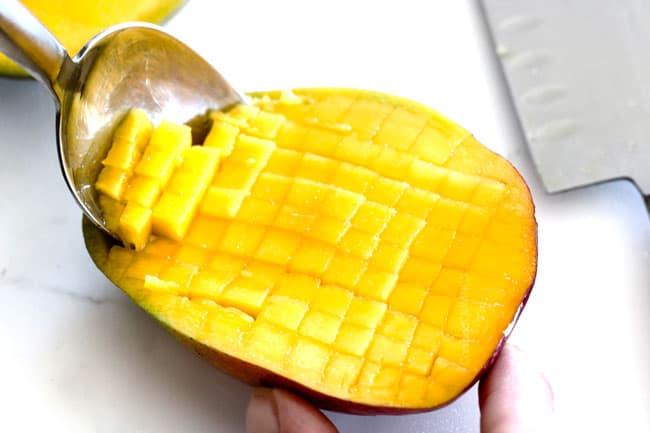 showing how to dice mango for mango chimichurri Steak