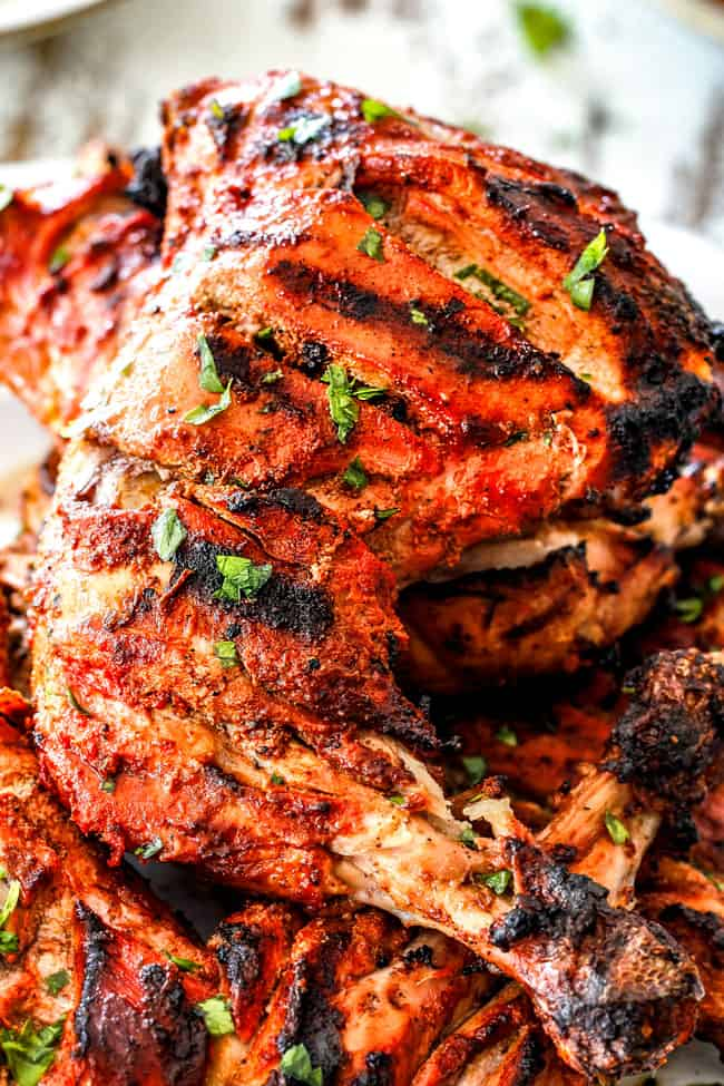 up close of Grilled Tandoori Chicken Recipe with slashed, marinated chicken