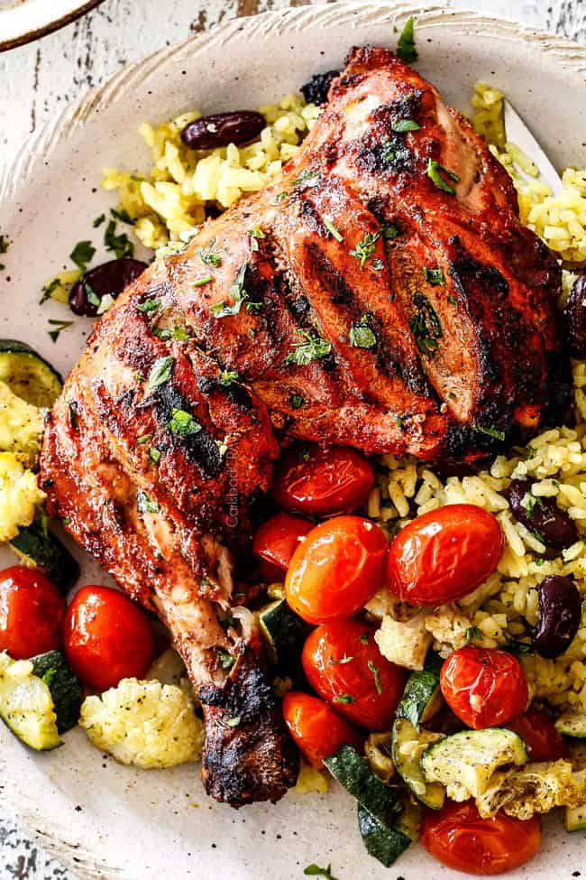 top view of authentic tandoori Chicken with Indian rice and roasted tomatoes