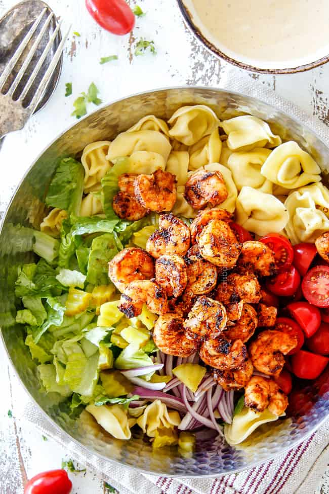 Top view of easy Shrimp Pasta salad with tortellini, lettuce, tomatoes and shrimp