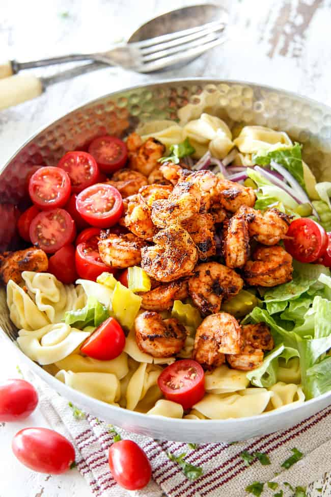 side view of Shrimp Pasta salad with tortellini, lettuce, tomatoes and shrimp