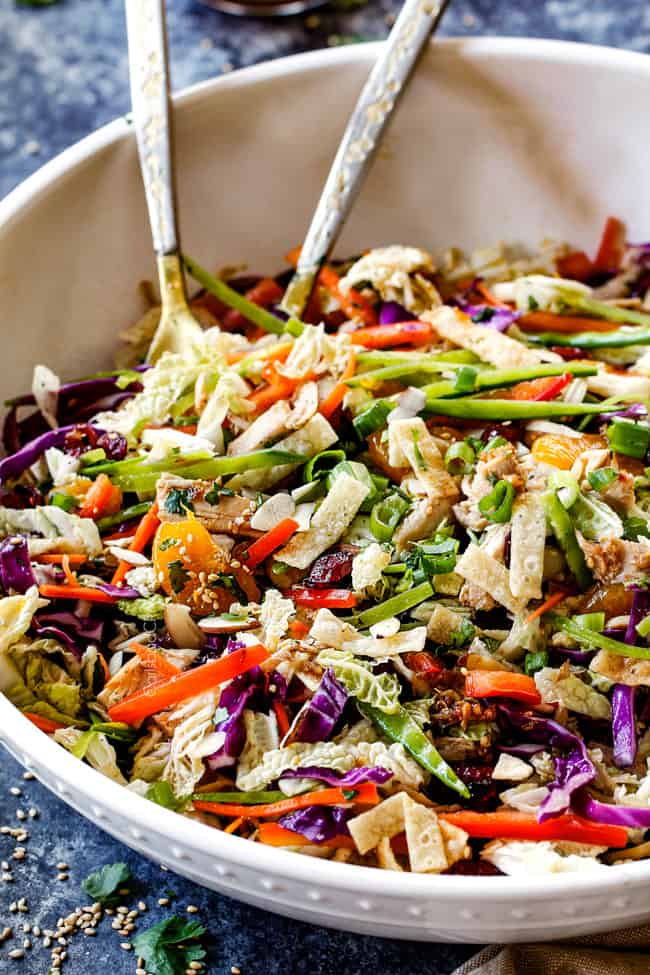 best ever Chinese chicken salad tossed together with mandarin oranges, peanuts napa cabbage, wontons, carrots, snow peas, red bell peppers and sesame dressing