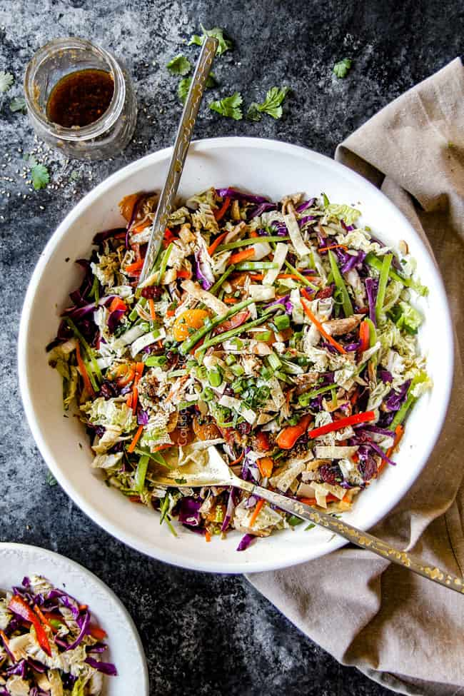 far away top view of best ever Chinese chicken salad tossed together with mandarin oranges, peanuts napa cabbage, wontons, carrots, snow peas, red bell peppers and sesame dressing