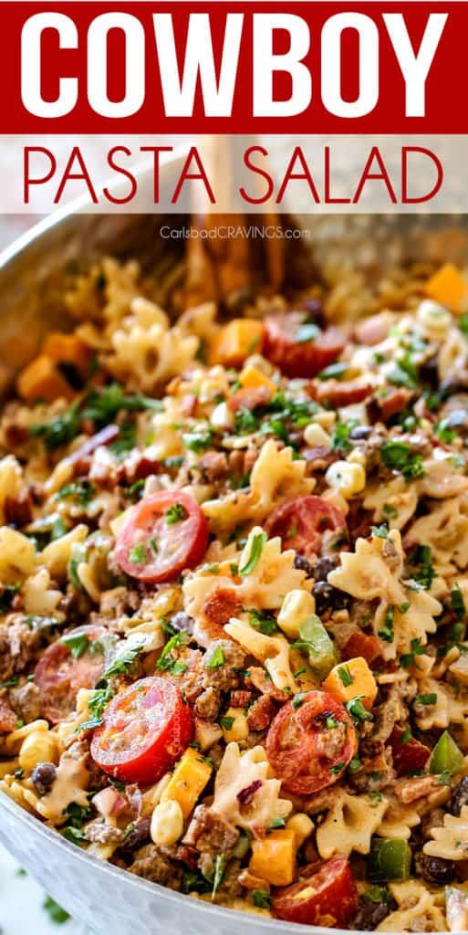 up close of Cowboy Pasta Salad with ground beef, black beans, corn, tomatoes and barbecue sauce in a metal bowl