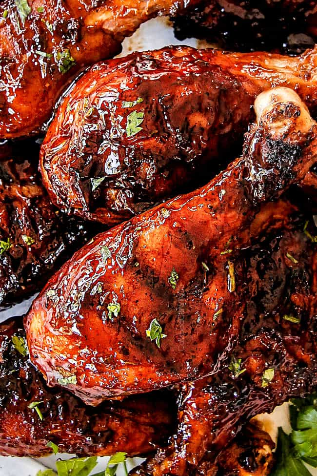 up close view of the best grilled BBQ chicken on a white plate