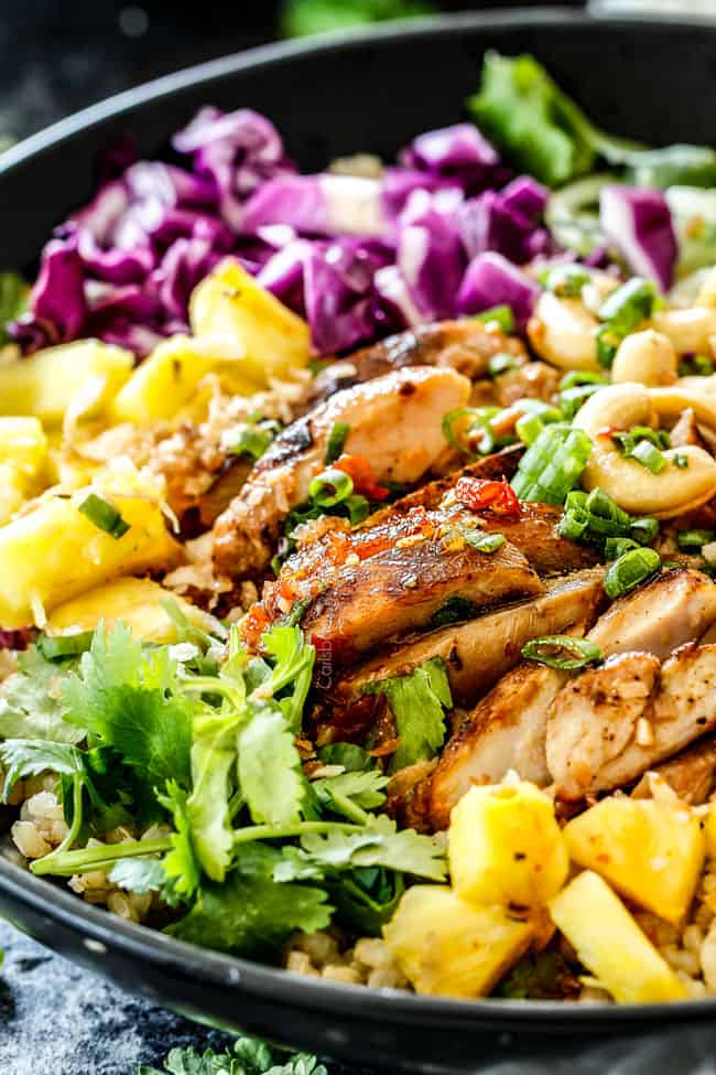 show how to serve lemongrass chicken in rice bowl with pineapple, cabbage and carrots