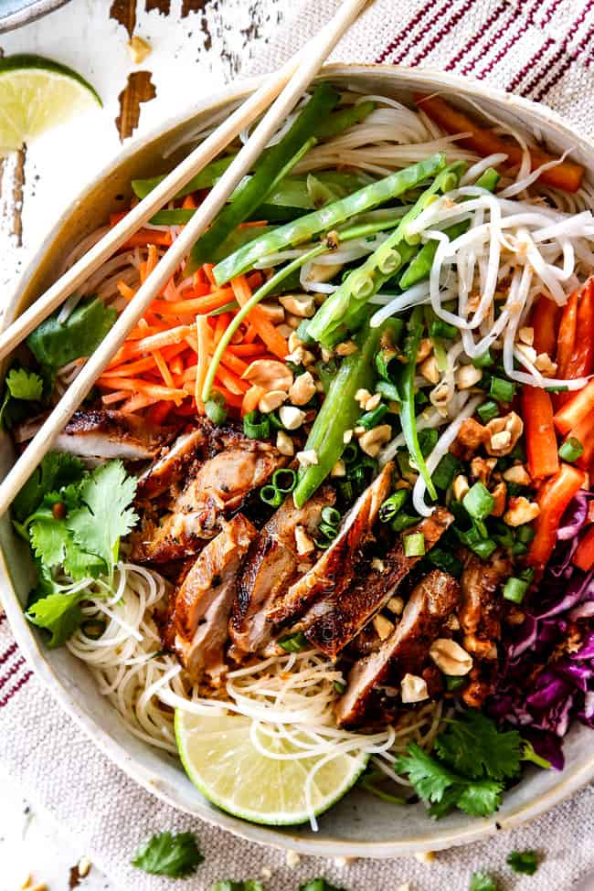 showing how to serve lemongrass chicken as salad with noodles, peas, carrots