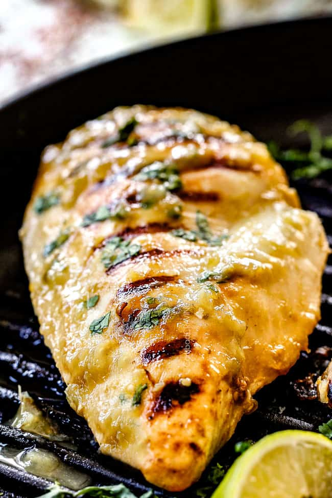 up close showing how to make salsa verde chicken by cooking salsa verde chicken in a skillet