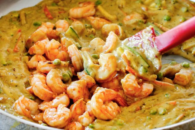 showing how to make Copycat Bang Bang Shrimp by adding shrimp to thai chili sauce