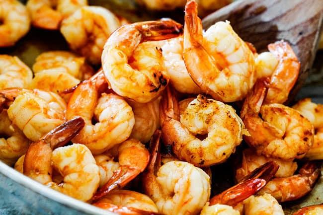 showing how to make Bang Bang Shrimp by cooking shrimp in a skillet