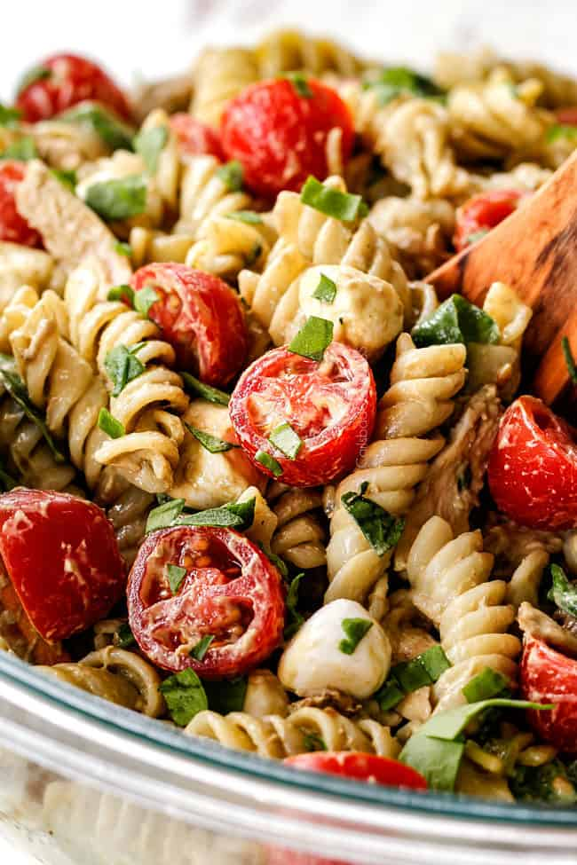 up close of a spoonful of healthy caprese pasta salad