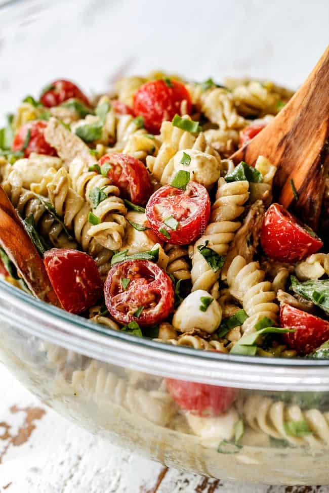 faraway shot of a spoonful of healthy caprese pasta salad