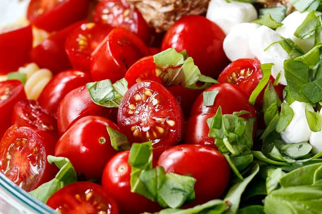 showing how to make caprese pasta salad with tomatoes