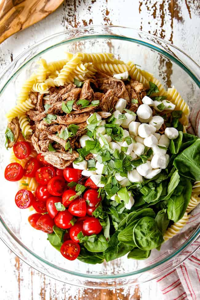 top view showing how to make caprese pasta salad with balsamic chicken, spinach tomatoes mozzarella