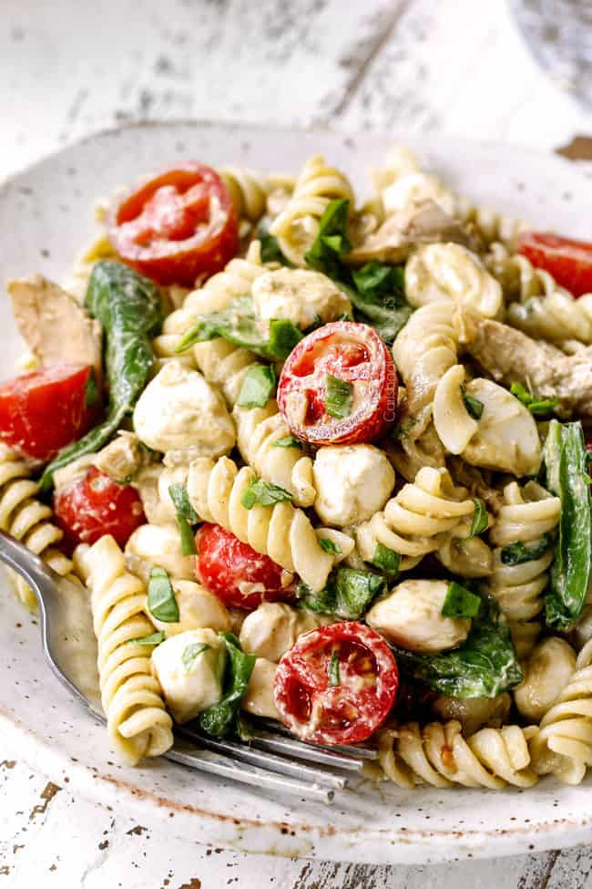 top view of a plate of caprese pasta salad with balsamic chicken