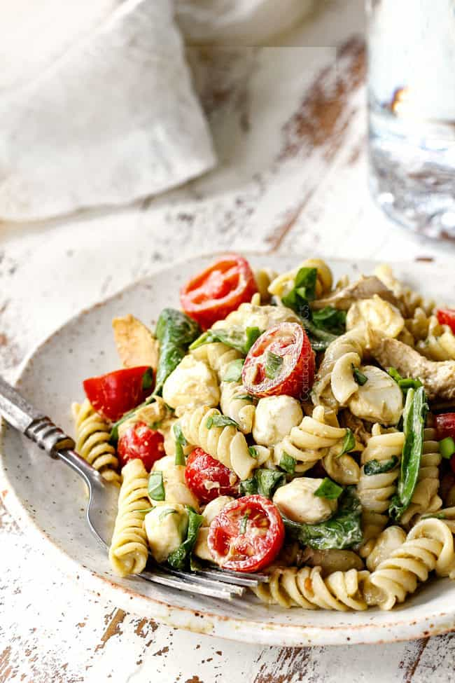 far away view of a plate of caprese pasta salad with chicken