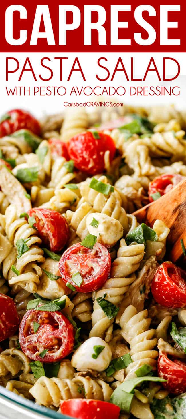 a spoonful of caprese pasta salad with pesto