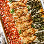 top view of sheet pan chicken and vegetables on a baking sheet