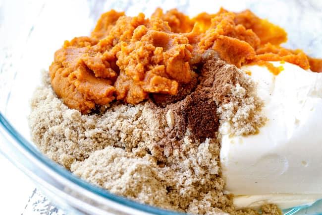 showing how to make pumpkin dip with cream cheese, brown sugar, pumpkin, cinnamon in a glass bowl
