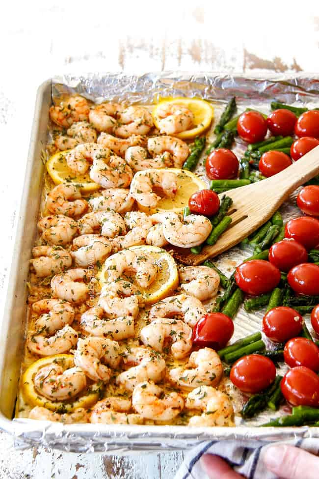 side view of shrimp scampi without wine with tomatoes and asparagus