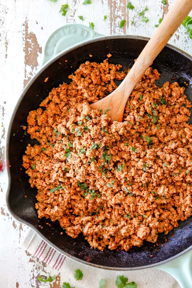 showing how to make turkey tacos by making ground turkey in a skillet with taco seasonings
