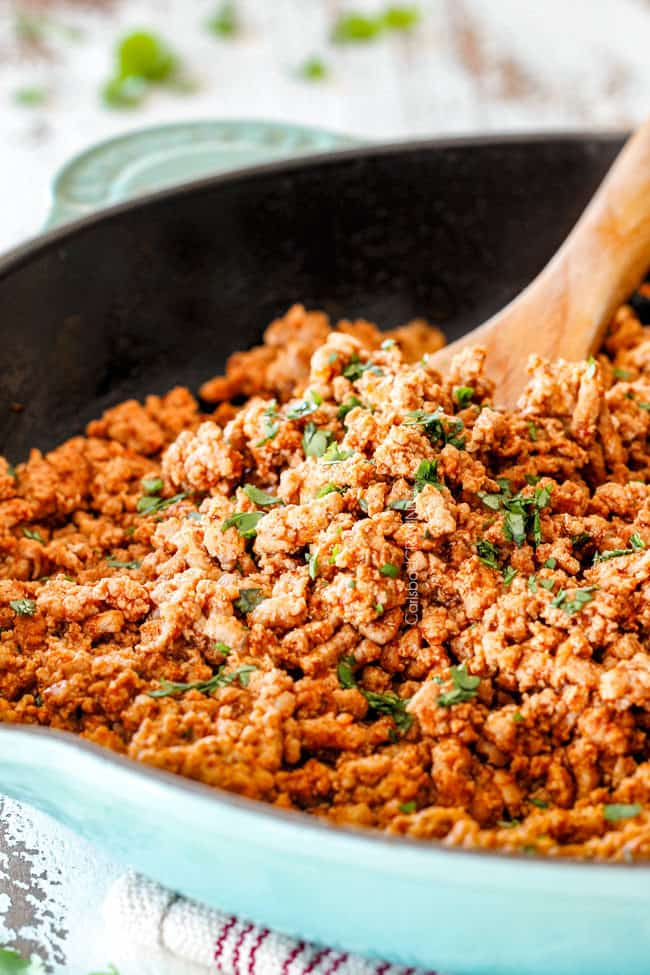 showing how to make ground turkey tacos by making ground turkey in a skillet with taco seasonings