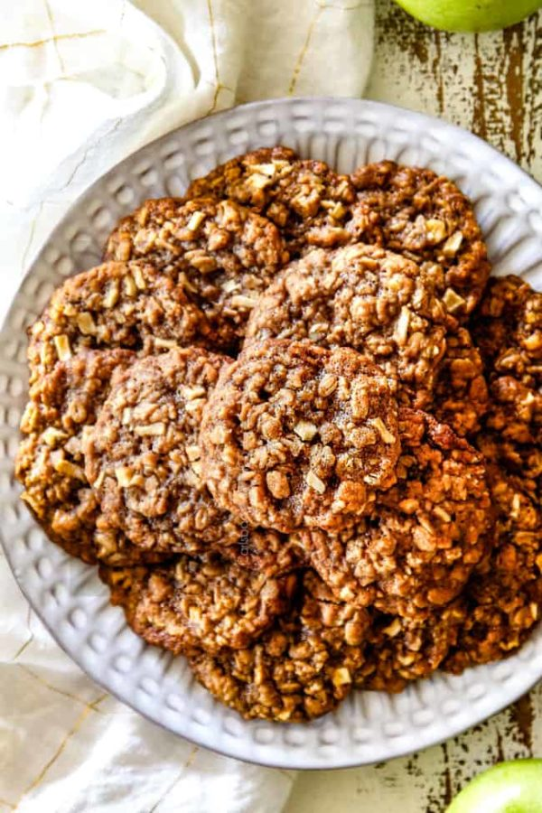 top view of apple oatmeal cookies o a white plate late