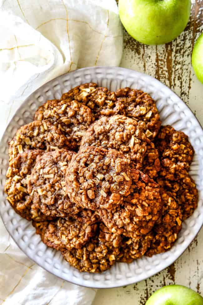 top far away view of oatmeal apple cookies o a white plate late