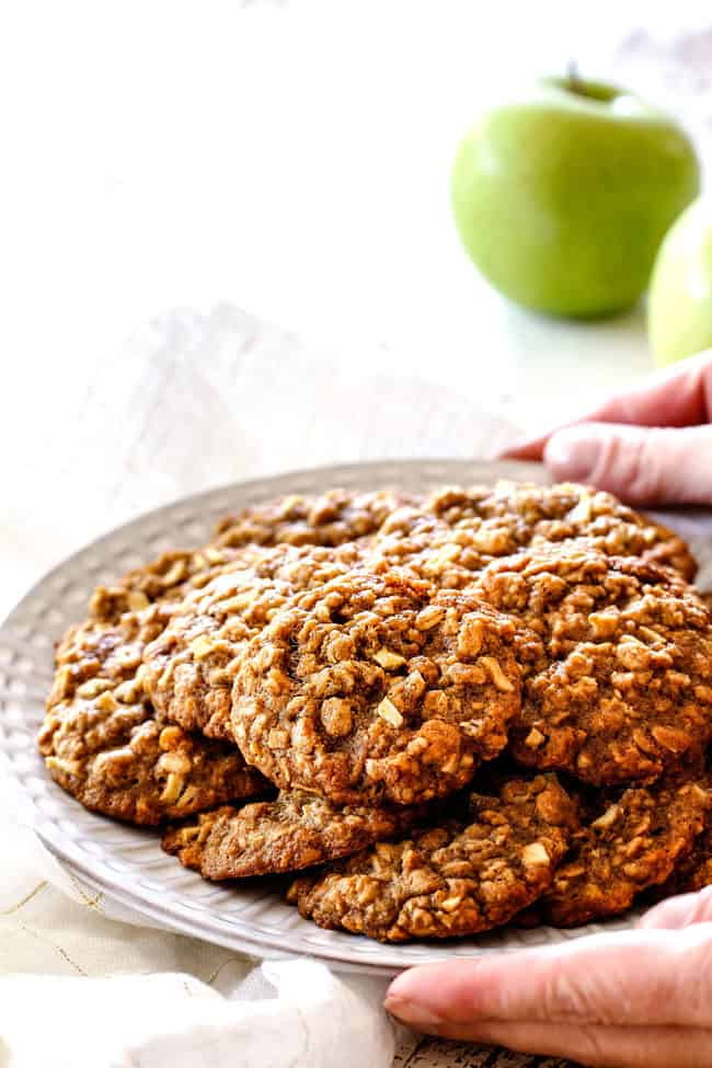 side view of plate of easy apple cookies with oatmeal on a white plate