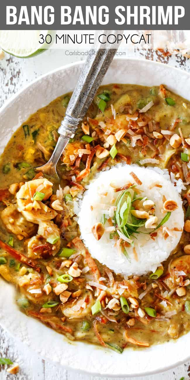 up close top view of Bang Bang Shrimp Copycat in a white bowl with a pile of rice in the center with coconut chili sauce