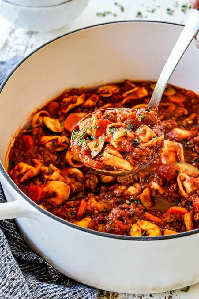 a ladleful of Italian sausage tortellini soup