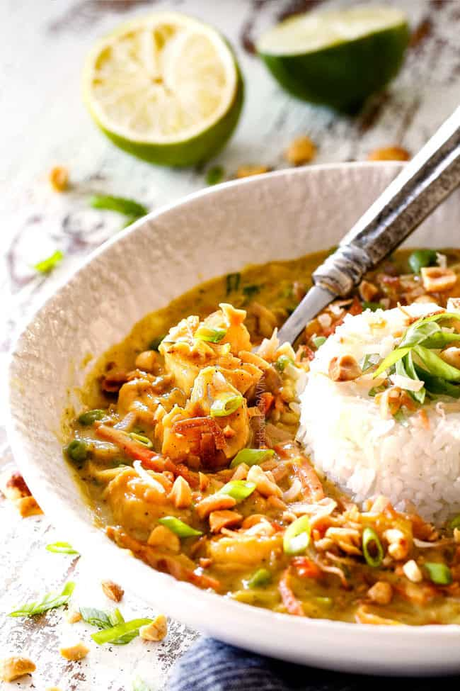 side view of Bang Bang Shrimp with rice and coconut in a white bowl
