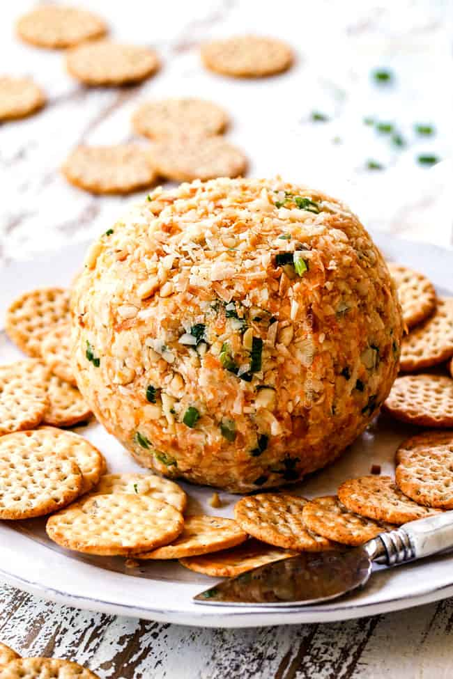 a Pineapple Cheese Ball on a platter with crackers