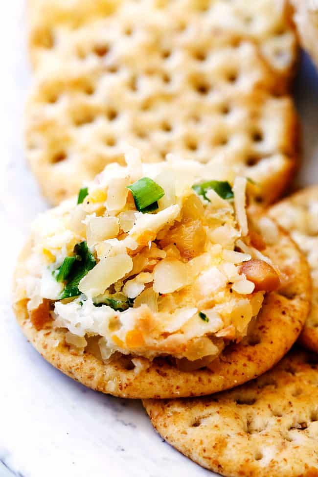 up close of Pineapple Cheese Ball spread on a cracker