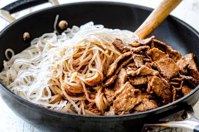 showing how to make Korean Spicy Noodles by adding cellophane noodles, spicy sauce and beef together in a skillet