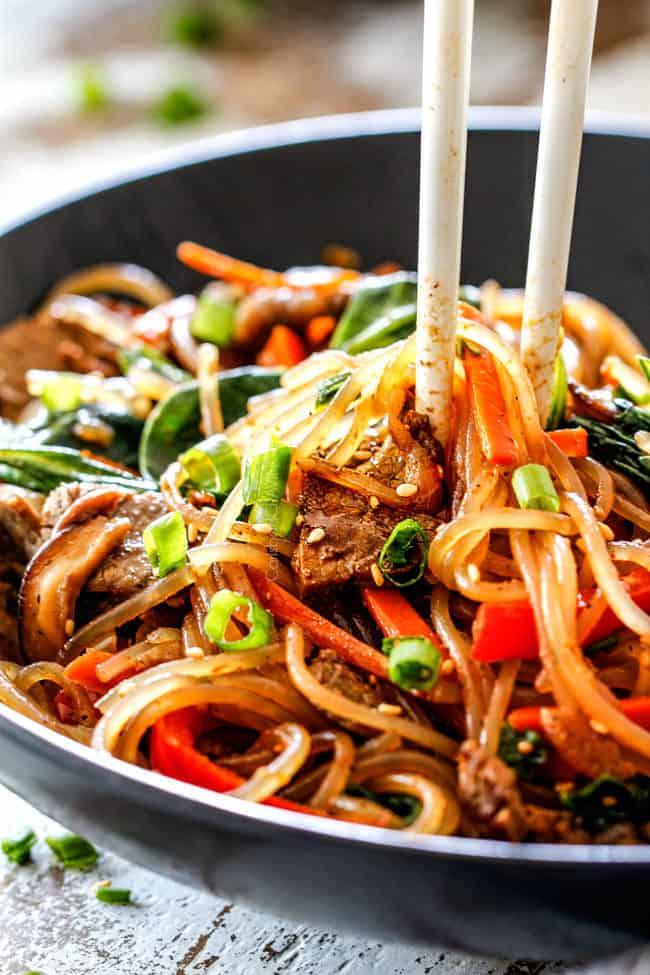 chop sticks grabbing a bite of Spicy Korean Noodles