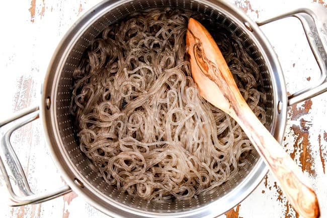 showing glass noodles in a strainer for Korean Spicy Noodles
