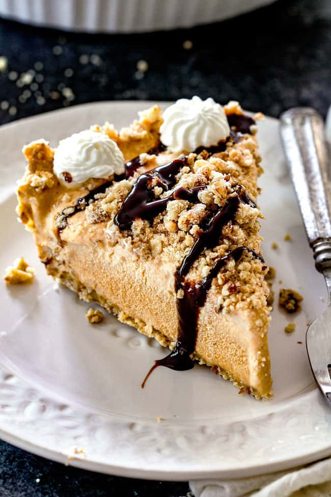 a slice of pumpkin ice cream pie with chocolate drizzle