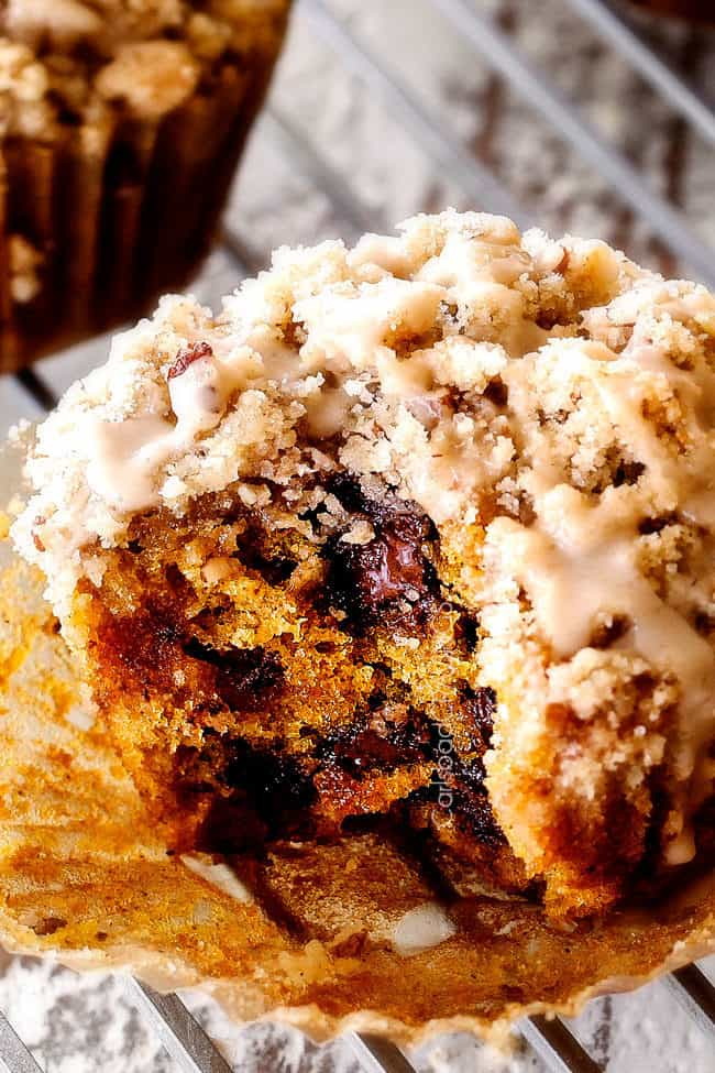 up close of the best pumpkin muffin with a bite out of it