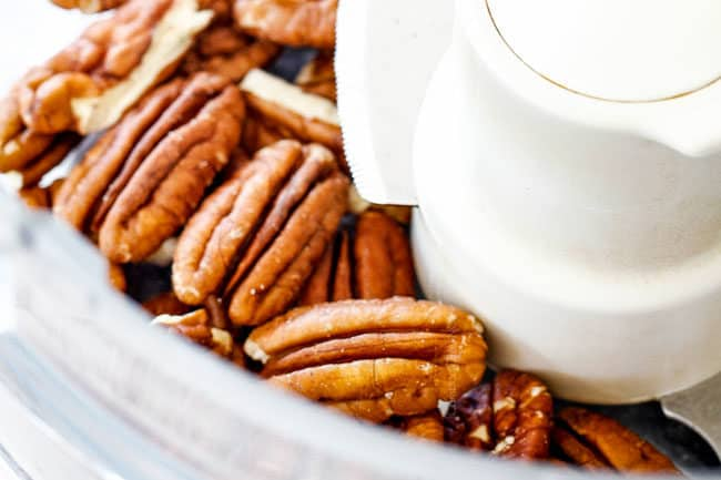 showing how to make easy pumpkin muffins by adding pecans to a food processor