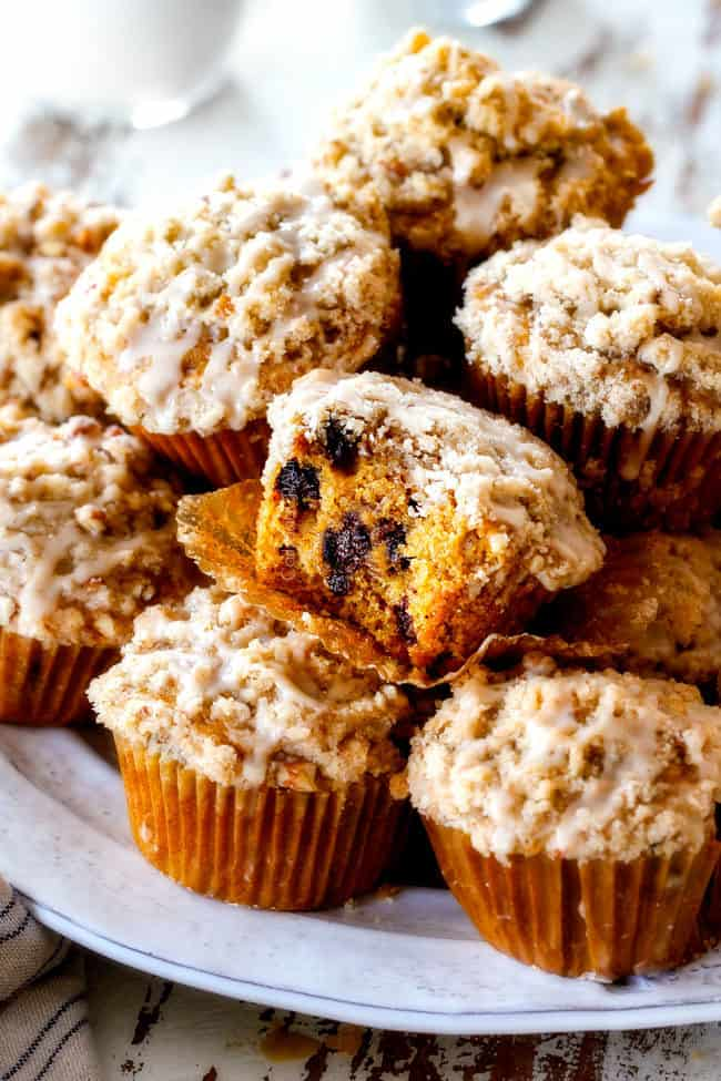 fresh pumpkin muffins stacked together on a plate