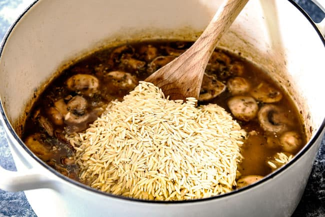 showing how to cook orzo pasta by adding orzo to chicken broth in a stock pot