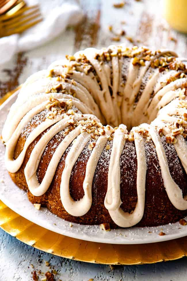 Eggnog Cake Recipe Bundt on a white platter with eggnog frosting