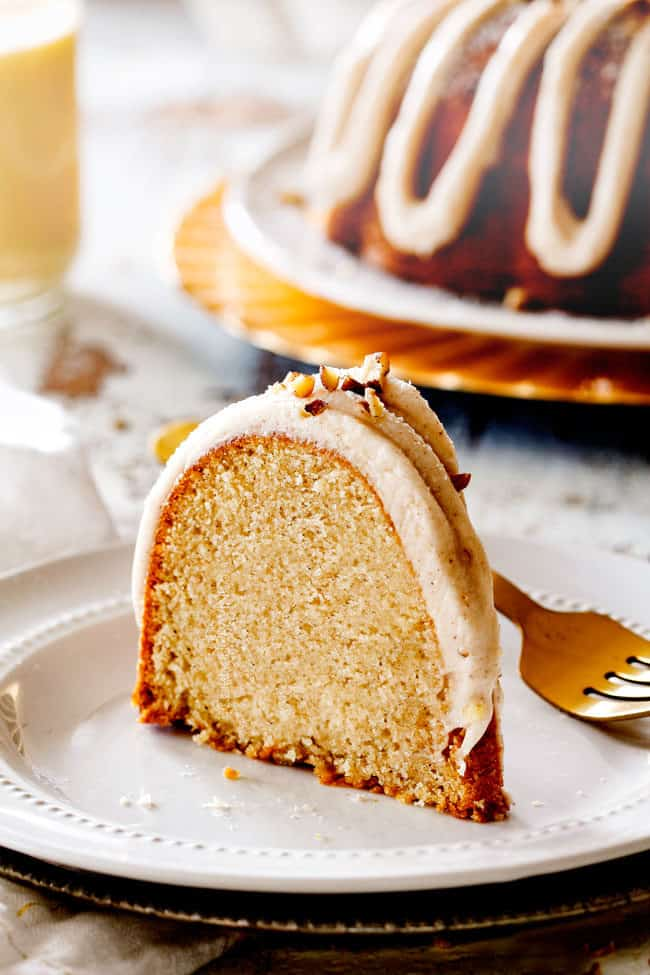a slice of best eggnog cake standing on a white plate
