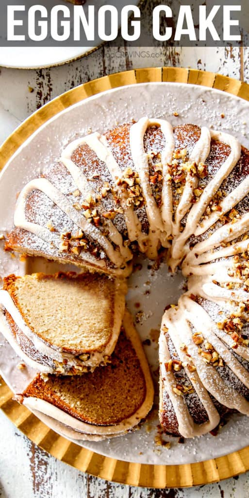 top view of southern Eggnog Cake on a white and gold platter with two slices cut and laying on their sides