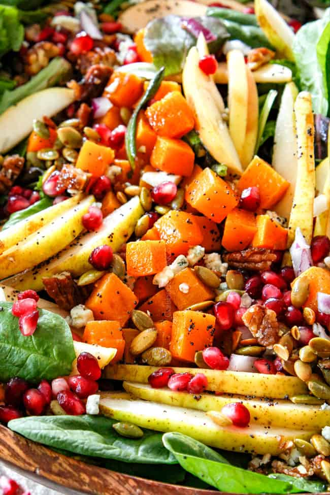 up close of Thanksgiving Fall Salad with pears, apples, pecans, cheese