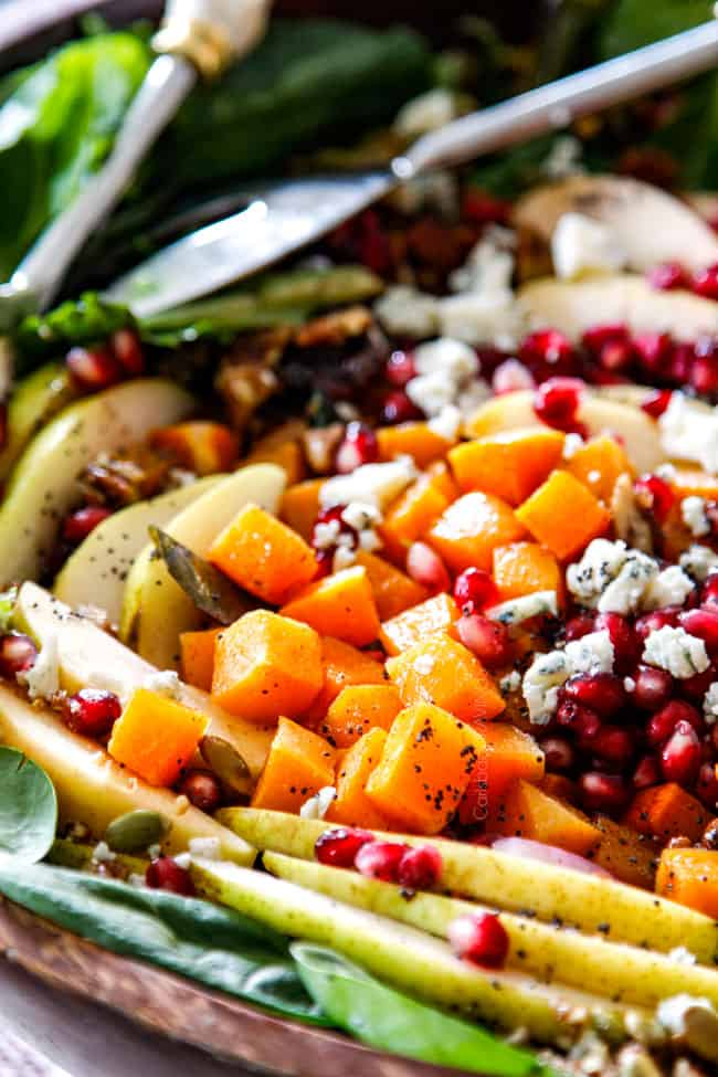 up close of pears, butternut squash, pomegranate seeds in Fall Salad