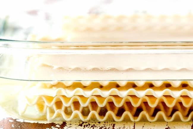 showing how to make lasagna by soaking lasagna noodles